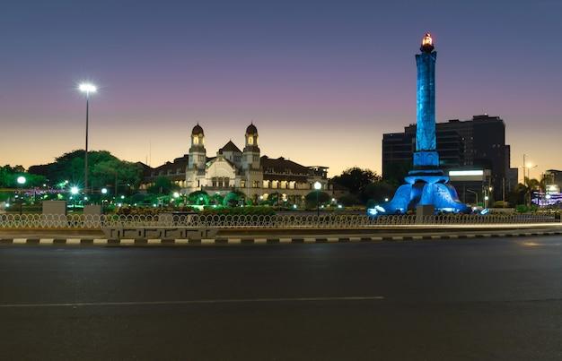 Tugumuda landmark on a beautiful morning with a background of lawang sewu semarang central java