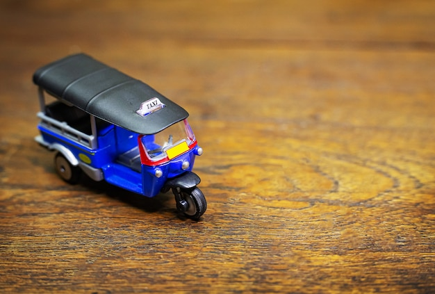 Tuk tuk taxi toy on wood table