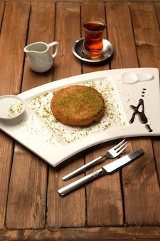 Tukish delight with grated pistachios called kã¼nefe