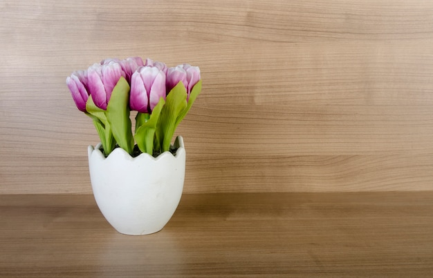 Tulip flowers against wooden background