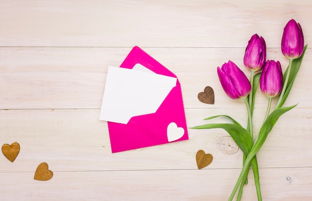 Tulip flowers with blank paper in envelope