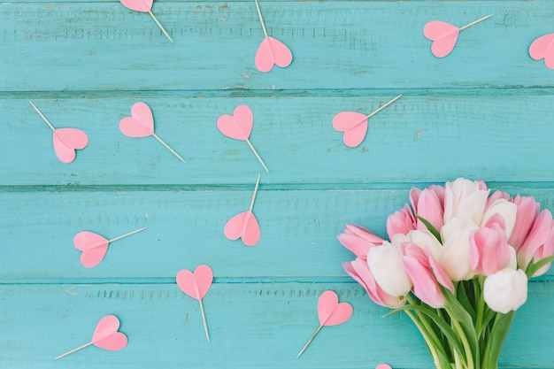 Tulip flowers with paper hearts