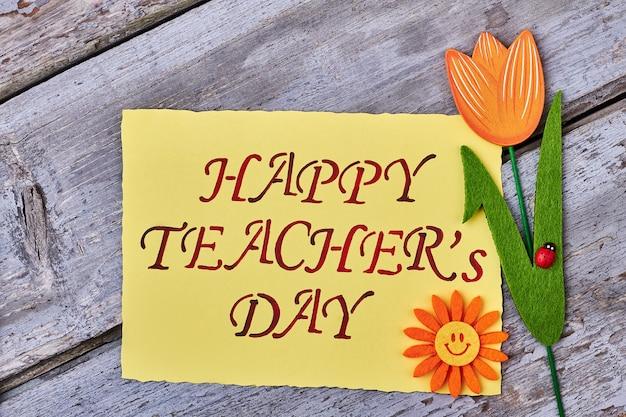 Тюльпан, божья коровка, открытка и солнце. учителю с любовью.