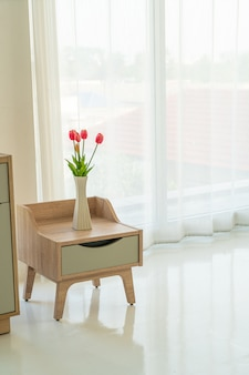 Tulip in vase on wooden table decoration in a room