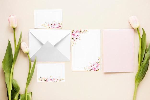 Tulips beside wedding invitation