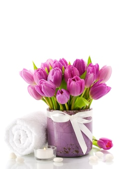 Tulips bouquet with towel and candle