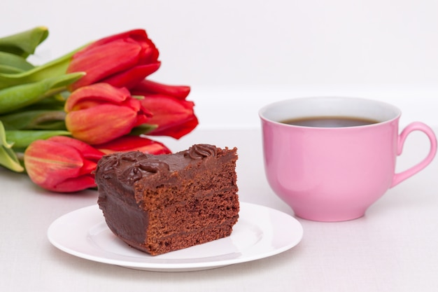 Tulips, cake, cup for mother, wife, daughter, girl with love. happy birthday,