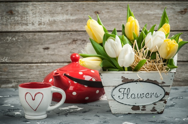 Tulips, cup and red polka dot teapot