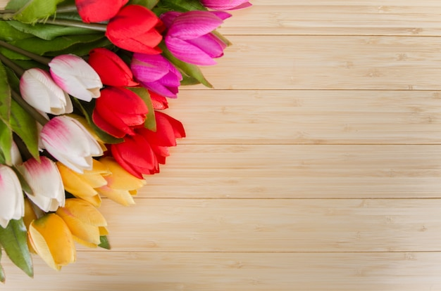 Tulips flowers arranged background with copyspace