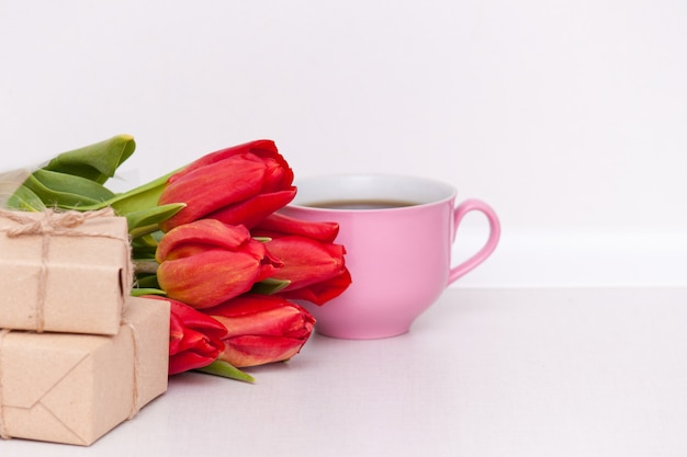 Tulips, presents, cup for mother, wife, daughter, girl with love. happy birthday,  copy spase.