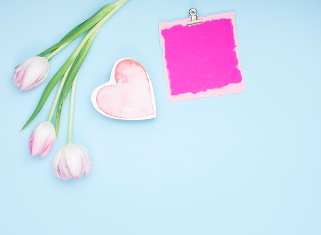 Tulips with blank paper and heart