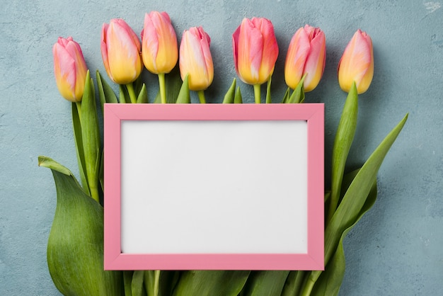 Tulips with frame on table
