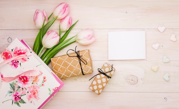 Tulips with gift boxes and blank paper