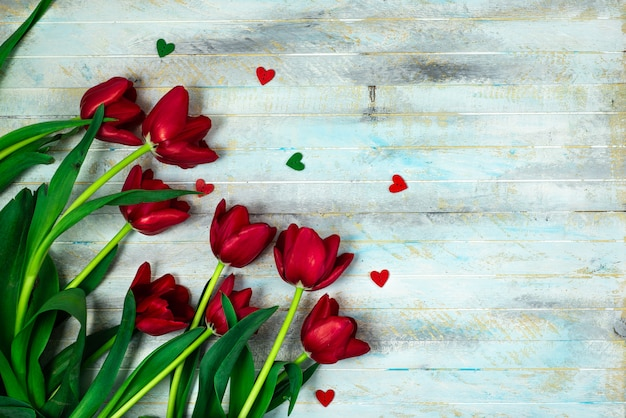 Tulips on a wooden patern background