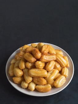 Tulumba tatlisi - traditional turkish desserts tulumba. arabic sweets celebration eid ramadan.