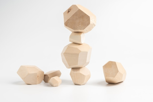Tumi-ishi puzzle game. construction of an unstable wooden block tower.