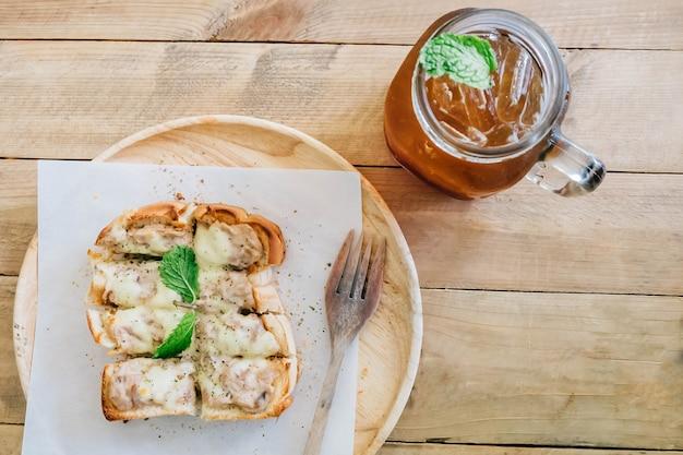 Tuna cheese toast with tea peach, top view