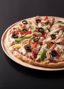 Tuna pizza isolated on black