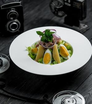 Tuna salad with eggs and potatoes