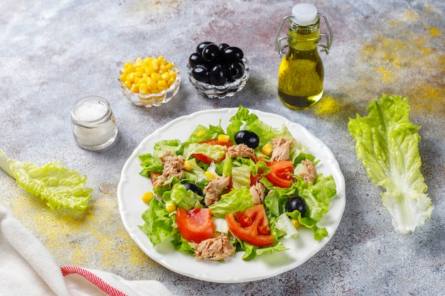 Tuna salad with lettuce,olives,corn,tomatoes