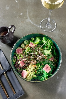 Tuna salad with spinach zucchini seaweed and beans