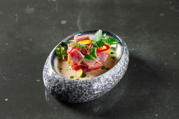 Tuna tartare with tomato lemon onion chili and fresh herbs in a crockery