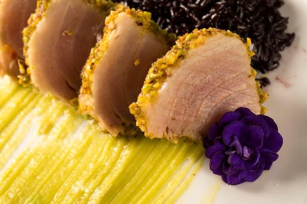 Tuna with pistachio crust, black rice and avocado puree