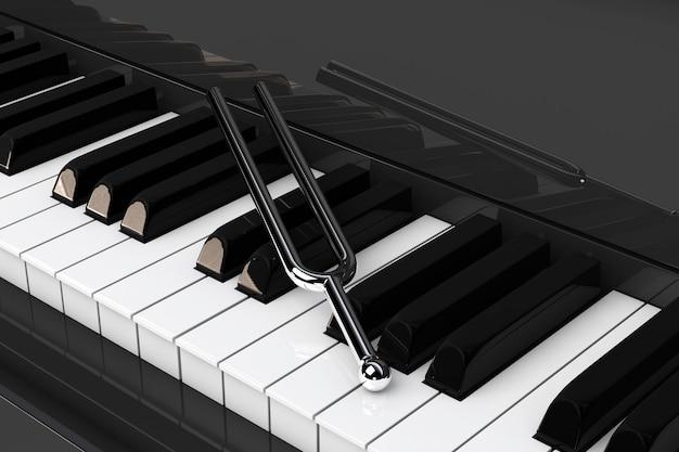 ピアノキーの極端なクローズアップの上に音叉。 3dレンダリング