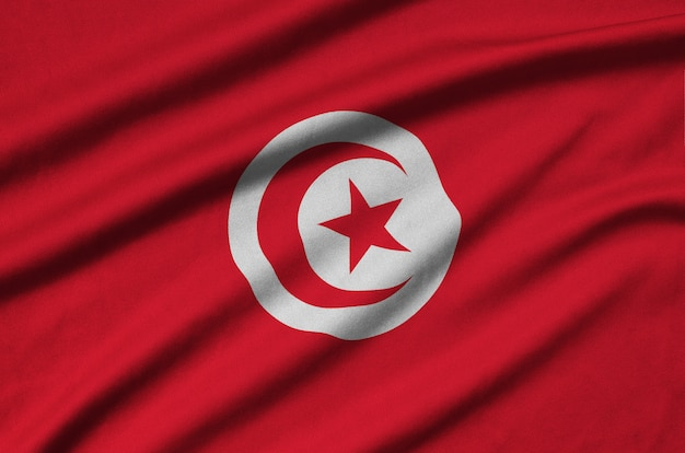 Tunisia flag  is depicted on a cloth fabric with many folds