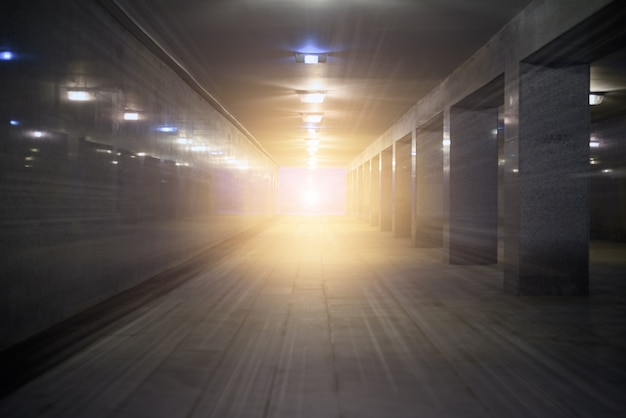 Tunnel underground pedestrian crossing with a bright glow at the end