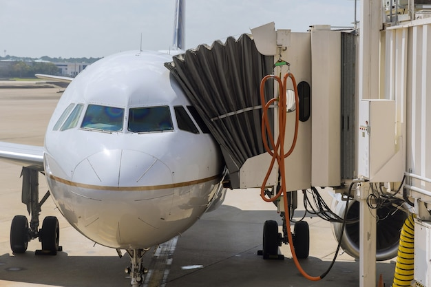 The turbine of the aircraft plane is preparing to fly at the airplane on the runway at the airport.