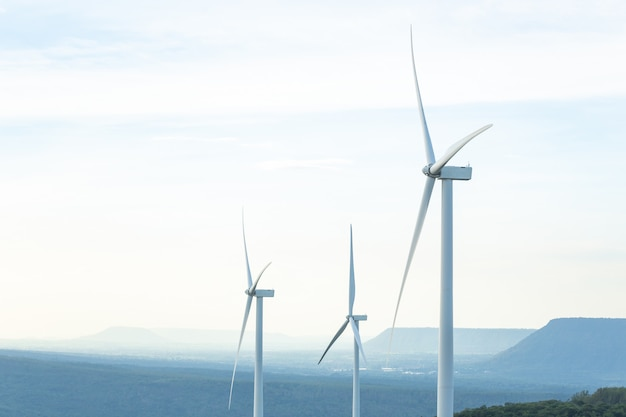 Turbine green energy electricity, windmill for electric power production, wind turbines generating electricity on the mountain , clean energy concept.