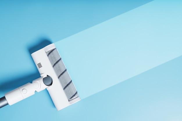 青い背景、上面図の現代掃除機のターボブラシノズル。クリーニングコンセプト