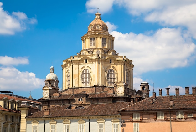 Turin, italy - circa august 2020: perspective on the elegant and baroque saint lawrence church in turin. amazing natural light with a blue sky.