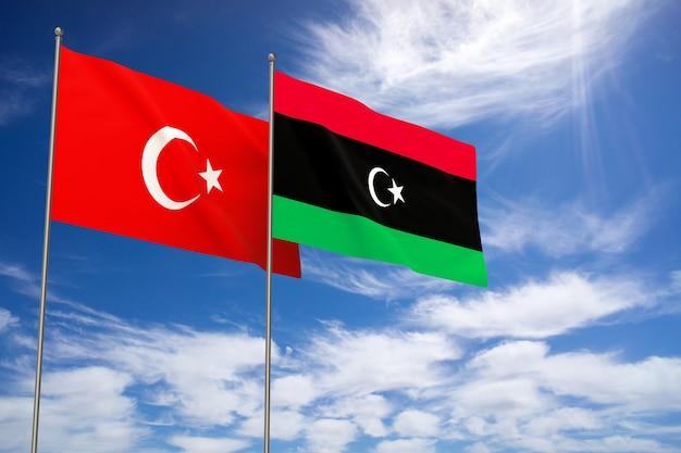 푸른 하늘 배경 위에 터키와 리비아 플래그입니다. 3d 일러스트레이션