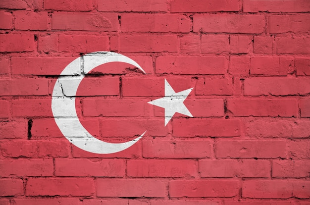 Turkey flag is painted onto an old brick wall