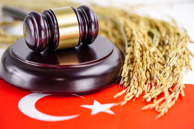 Turkey flag and judge hammer with gold grain from agriculture farm.