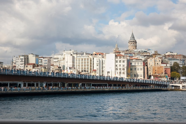 Turkey, istanbul. a view of the galata bridge and the galata tower and a beautiful cloudy sky