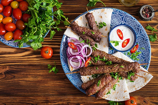 Premium Photo Turkish And Arabic Traditional Ramadan Mix Kebab Plate Kebab Adana Chicken Lamb And Beef On Lavash Bread With Sauce
