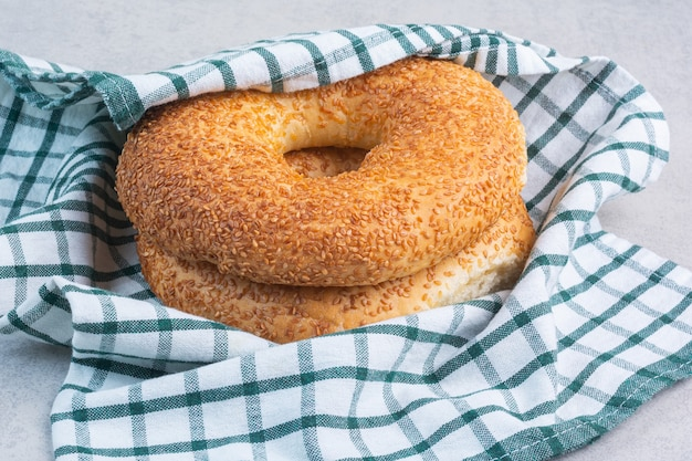 Turkish bagels on a tea towel, on the marble background.
