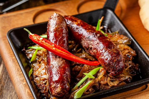 Turkish beef sausages with stewed cabbage