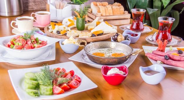Turkish breakfast - fried egg, bread,cheese, salad and tea - image