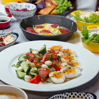 Turkish breakfast plate with boiled eggs, tomato, cucumber