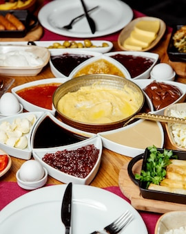 Turkish breakfast setup with cheese jams egg dish chocolate butter and others