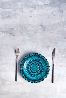 Turkish ceramics decorated blue plate with new luxury black cutlery