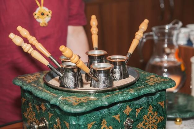 Turkish coffee brewed on sand in cezve. oriental, east coffee