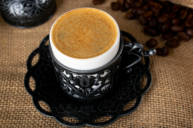 Turkish coffee. oriental tableware with a pattern. coffee beans, turkish delight