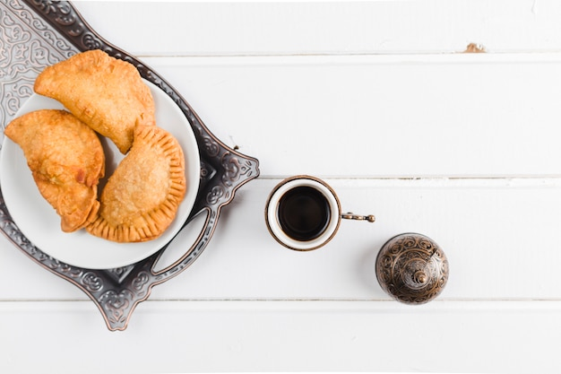 Turkish coffee and pasties on tray