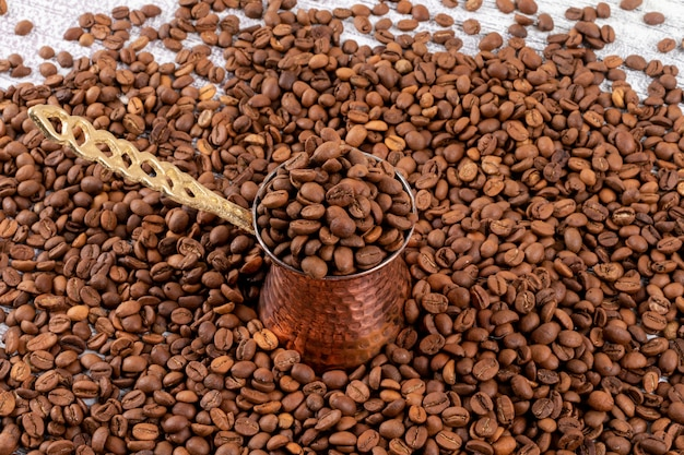 Turkish coffee pot on coffee beans