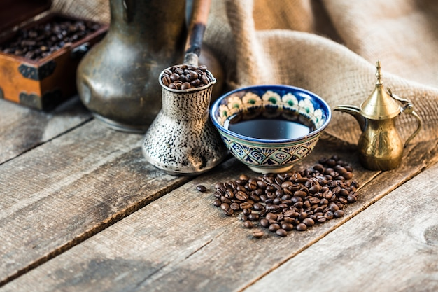 Turkish coffee pot on wooden table. aroma drink beverage
